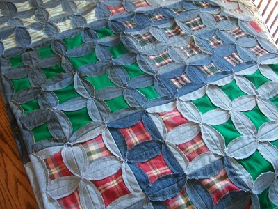 Denim and plaid flannel quilt.
