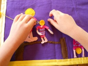 Sewing on one of the balance beam gymnasts.