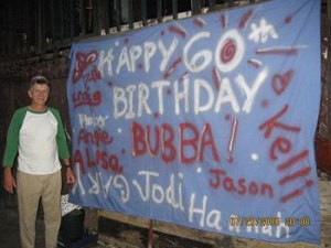 Blue sheet with birthday wishes painted on it.