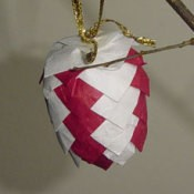 Finished red and white paper pinecone.
