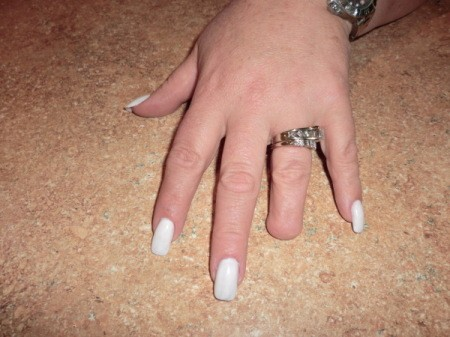 nails painted with white polish