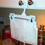 Clip hanger used for holding recipe, from cupboard knob.