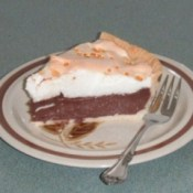 Slice of pie on plate with a fork.