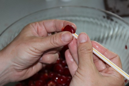 Removing pits from pie cherries using a straw