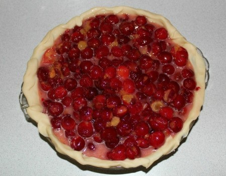 Pour cherry pie filling into pie shell