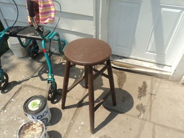 A brown wooden stool.