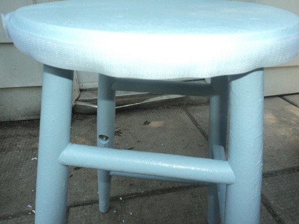 Velcro attached to the wooden stool.
