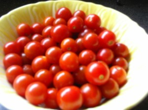 Bowl of ripe cherry tomatoes.