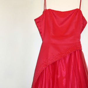 A red spaghetti strap prom dress