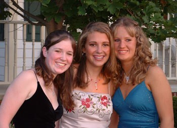 Three girls dressed up for Homecoming