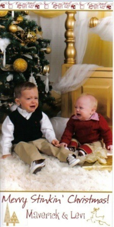 Two boys crying in front of tree