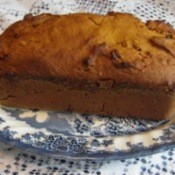 Pumpkin bread on blue and white plate.
