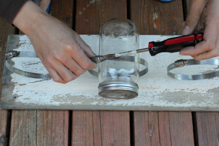 Placing the canning jars in the clamps.