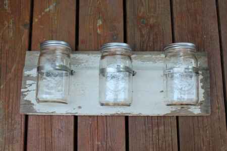 Clamps with canning jars in them.