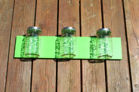 Canning Jars on green wood