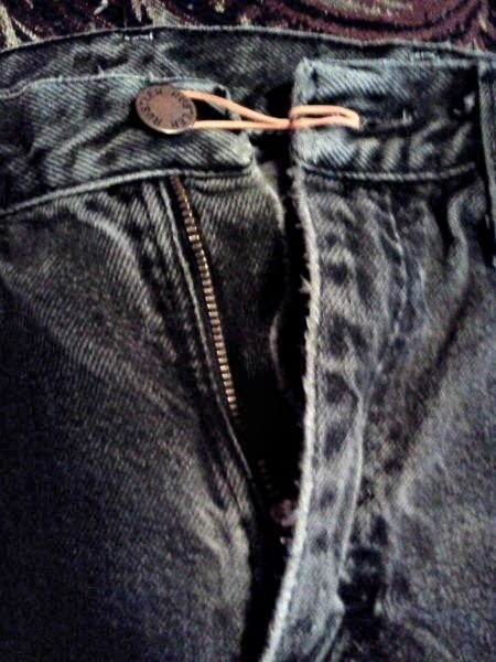 Rubber band on jeans button.