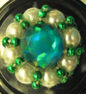 Light blue, pearl, and green bead arrangement.
