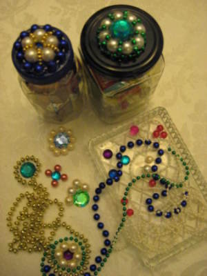 Two jars with finished lids, motifs, and beads.