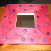 Pink painted mirror with flat glass beads.