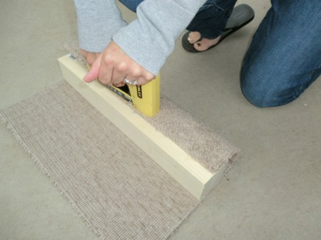 Attaching carpet to post.