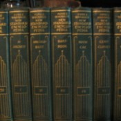 Closeup of the spine of several volumes.