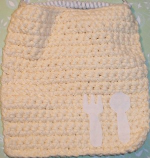 Pink washcloth bib.
