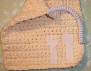 Bib with closeup of shoe string tie.