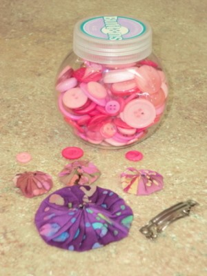 Supplies for pink and purple barrette.