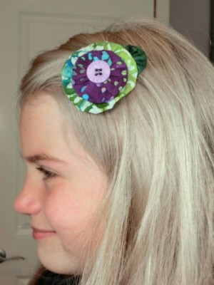 Our Thriftyfun model wearing the green and purple barrette.