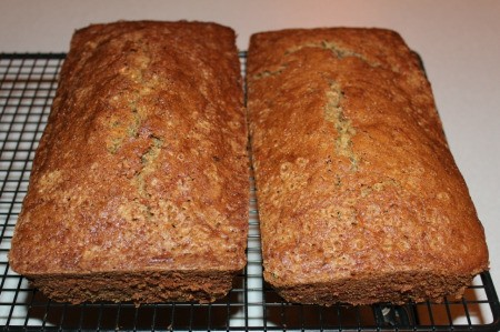 2 loaves of zucchini bread cooling on rack
