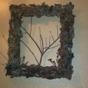 Bark covered picture frame with additional twigs added for interest.