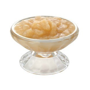 Glass stemed dish of apple sauce.