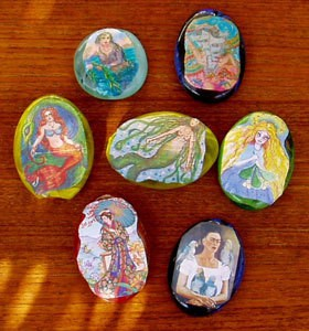 Mermaid paperweights.