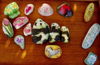 Variety of paper weights with animal motifs.