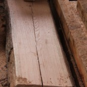 Oak plank with cracks.