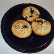 3 lemon poppy seed blueberry muffins on a plate