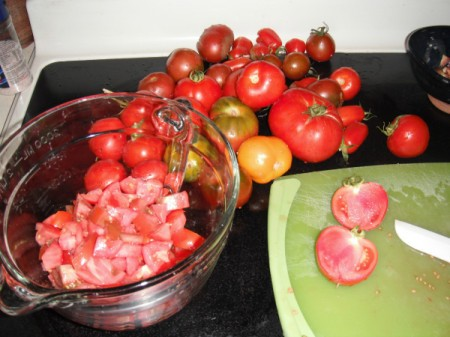 Garden tomatoes being chopped for soup