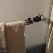 Hair clips on towel bar.