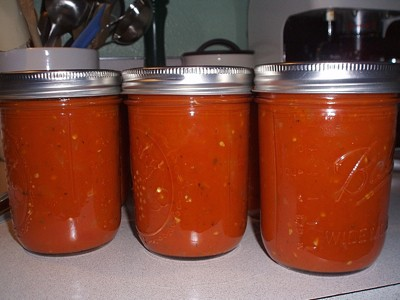 Jars of canned tomato sauce.
