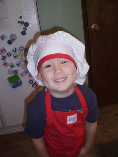A child chef after making tomato sauce