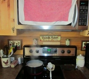 Use a Towel to Catch Steam from Cooking
