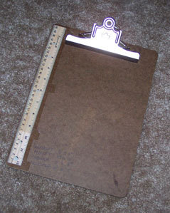 Ruler attached to clip board.
