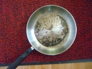 A badly burned stainless steel pan
