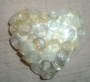 Buttons made into a heart shaped pin.