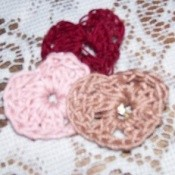 Crocheted hearts in 3 colors.