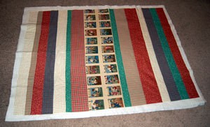 Strip pieced quilt.