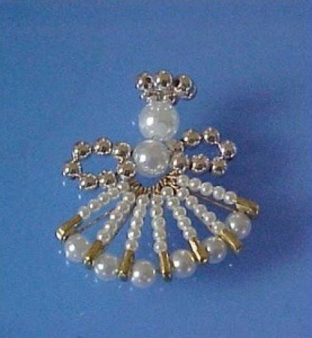 Angel pin in gold, silver, and pearl.