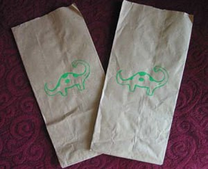 Dinosaur stenciled brown paper bags.
