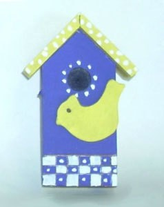 Decorative blue and yellow birdhouse.