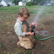 Child Helping with Watering
